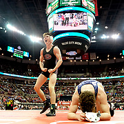 Genoa's Dustin Morgillo, left, celebrates after defeating Ashtabula St. John's Nick Burgard at 145 pounds during the Division III OHSAA state individual wrestling championship finals at Schottenstein Center at The Ohio State University in Columbus on Saturday, March 9, 2019. THE BLADE/KURT STEISS