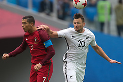 June 24, 2017 - Saint Petersburg, Russia - Tommy Smith (R) of the New Zealand national football team and Cristiano Ronaldo of the Portugal national football team vie for the ball during the 2017 FIFA Confederations Cup match, first stage - Group A between New Zealand and Portugal at Saint Petersburg Stadium on June 24, 2017 in St. Petersburg, Russia. (Credit Image: © Igor Russak/NurPhoto via ZUMA Press)