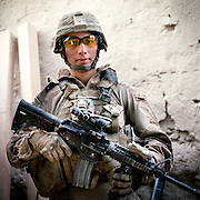 """Location:<br /> Patrol Base Fires, Sangin District, Helmand Province, Afghanistan<br /> <br /> Unit: <br /> 3rd Squad, 1st Platoon, Bravo Company, 1st Battalion, 5th Marines<br /> <br /> Name and Rank: Lance Corporal Jeffrey Lopez<br /> <br /> Age: 22<br /> <br /> Hometown: Ventnor City, New Jersey<br /> <br /> Interview selections:<br /> <br /> Why did you join the Marines?<br /> <br /> """"I joined the Marine Corps because one of my boys died in Iraq. He was in the Army, and I had three other boys, they were in the Marine Corps. And I saw that they deployed too, and they all made it back alive. So I figured I would go Marine Corps.""""<br /> <br /> Describe Sangin:<br /> <br /> """"Sangin's crazy. I mean it looks nice, as far as its features, like trees and all that, it looks like a beautiful country. But as far as steppin' outside the wire with all your gear, it's shitty . . . I can't really explain it. It's somewhere you don't wanna be.""""<br /> <br /> Why do you think the Taliban are fighting?<br /> <br /> """"I think the Taliban's out here doing what they do because they don't want us controlling what they do . . . it's just like your parents telling you, 'Hey do this.' Like, they don't like authority, I guess. So we come here, 'Hey this is how you're gonna live your life,' and it's like, """"No, we're gonna fucking still be the rebels we are, not caring about other peoples' lives, still trying to get these drugs out.'""""<br /> <br /> How do you rate them as a fighting force?<br /> <br /> """"They fight like fake ass gangs back in the States. If they're not in a big group or whatever, if they can't get that upper hand, they're not even gonna try to face you. They're just gonna fall back . . . I mean if they were to step up and try to fight us like we fight them, they wouldn't stand a chance.""""<br /> <br /> """"Like planting IEDs, shooting as us from where we can't see them, hiding behind stuff.""""<br /> <br /> What's your job in the squad?<br /> <br /> """"Lately I've been sweeping, that's """