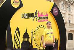 A runner stands with a medal during the 2018 London Landmarks Half Marathon. PRESS ASSOCIATION Photo. Picture date: Sunday March 25, 2018. Photo credit should read: Steven Paston/PA Wire