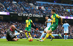 Robbie Brady of Norwich City holds off Fernandinho of Manchester City to allow John Ruddy to collect the ball - Mandatory byline: Matt McNulty/JMP - 07966 386802 - 31/10/2015 - FOOTBALL - City of Manchester Stadium - Manchester, England - Manchester City v Norwich City - Barclays Premier League