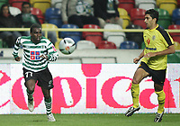"""PORTUGAL - AVEIRO 21 NOVEMBER 2004: (L to R) TINGA #77 and MARIO LOJA #5 in the 11¼ leg of the Super Liga, season 2004/2005, match  SC Beira Mar vs Sporting CP (2-2), held in """"Mario Duarte"""" stadium,  21/11/2004  01:23:16<br />(PHOTO BY: NUNO ALEGRIA/AFCD)<br /><br />PORTUGAL OUT, PARTNER COUNTRY ONLY, ARCHIVE OUT, EDITORIAL USE ONLY, CREDIT LINE IS MANDATORY AFCD-PHOTO AGENCY 2004 © ALL RIGHTS RESERVED"""