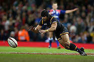 Leigh Halfpenny of Wales  dives on the ball to score a try but its not allowed as the referee blows his whistle for an infringement. Under Armour 2016 series international rugby, Wales v Japan at the Principality Stadium in Cardiff , South Wales on Saturday 19th November 2016. pic by Andrew Orchard, Andrew Orchard sports photography
