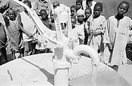 MALI. Menaka. 22/02/1987: Children around the new water pump installed at the maternity on the occasion of president Moussa Traore's visit.
