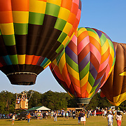 Colorful hot air balloons lift off with adventurous passengers for a Birdseye view of the Virginia countryside at the Flying Circus Balloonfest in Bealton, VA