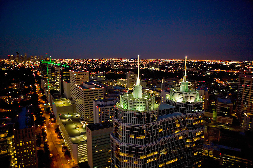 Aerial of Houston, Texas at night featuring O'Quinn Medical Tower at St. Luke's Hospital in the foreground.