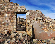 The Wall And Window Of A Crumbling And Ruined Building At Rhyolite Nevada, An Abandoned Town Near Death Valley California, USA
