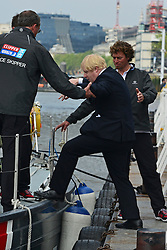 © Licensed to London News Pictures. 31/05/2013. London, UK BORIS JOHSNON is helped aboard. London Mayor Boris Johnson and yachtsman Sir Robin Knox-Johnston attend a photocall at the start and finish line of the 2013-14 Clipper Round the World Yacht Race. The race will leave London on 1 September 2013 and not return until July 2014. Photo credit : Stephen Simpson/LNP