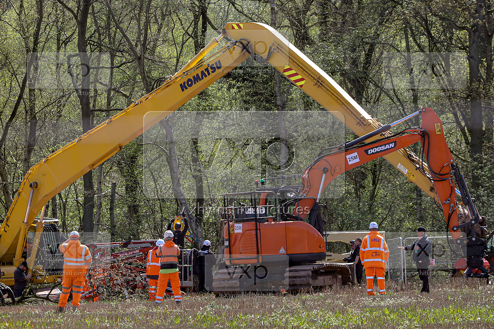 "Bailiffs and Police are seen gathered around a tree cutting truck in Crackley Woods HS2 site to remove an environmental activist who climbed the machine's cutting hand in an attempt to prevent them from cutting the ancient woods on Wednesday, April 15, 2020. (Photo/Vudi Xhymshiti)<br /> One of the biggest arguments against HS2 is around how it might impact on the country's green spaces and countryside. The Wildlife Trust claimed in a recent report that ""the deep cut HS2 will make across the landscape could stop nature's recovery in its tracks."""