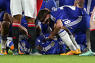 Kurt Zouma of Chelsea lies injured after falling awkwardly as he attempted to control the ball in the air. Barclays Premier league match, Chelsea v Manchester Utd at Stamford Bridge in London on Sunday 7th February 2016.<br /> pic by John Patrick Fletcher, Andrew Orchard sports photography.