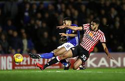 Birmingham City's David Davis (left) scores his side's first goal of the game ahead of Sunderland's Jake Clarke-Salter
