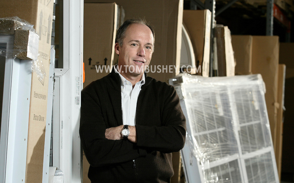 Rich Rowley, CEO of Rowley Building Products, poses for a photograph in the company's warehouse on Golf Links Road in the Town of Wallkill on March 17, 2006..