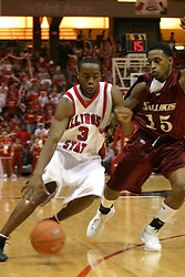 01 January 2006..Nedu Onyeuku turns it on going past the three point mark and Saluki Tony Young...The Southern Illinois Saluki's chewed up the Illinois State Redbirds with 37 points in the 2nd half to beat the birds with a final score of 65-52.  An audience of just over 7500 watched the in Redbird Arena on the campus of Illinois State University in Normal Illinois.....