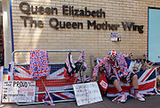 Royalist sits on bench as tension mounts outside St Mary's Hospital, Paddington London, where media and royalists await news of Kate, Duchess of Cambridge's impending labour and birth. Some have been camping out for up to two weeks during a UK heatwave, having bagged the best locations where an heir to the British throne will eventually be shown to the world.