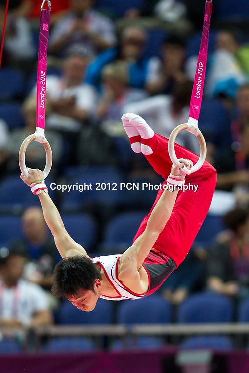 Kazuhito Tanaka (JPN) competing on the Rings during the Men's Team Gymnastics Qualification at the Olympic Summer Games, London 2012