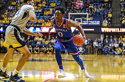 Jan 19, 2019; Morgantown, WV, USA; Kansas Jayhawks guard Marcus Garrett (0) drives down the lane during the first half against the West Virginia Mountaineers at WVU Coliseum. Mandatory Credit: Ben Queen-USA TODAY Sports