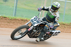 AMA Pro Class Flattracker Robert Pearson of Mossville, IL slides around the curve at the Pappy Hoel Half Mile Classic at the Sturgis Fairgrounds during the annual Sturgis Black Hills Motorcycle Rally. SD, USA. August 6, 2014.  Photography ©2014 Michael Lichter.
