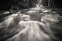 spring runoff on Hancock Brook in the Green Mountains of northern (Worcester) Vermont black and white