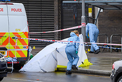 © Licensed to London News Pictures. 21/08/2021. London, UK. Forensic investigators at the scene of a fatal stabbing in Kingston. Police were called to a disturbance on Clarence Street at 03:45BST where they found a 22-year-old male with a stab injury to the chest, he was taken to hospital by London Ambulance Service where he was pronounced dead. An 18-year-old male was arrested at the scene on suspicion of murder.Photo credit: Peter Manning/LNP