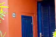 Collioure. Roussillon. A door. Blue against red ochre ochra wall. France. Europe.
