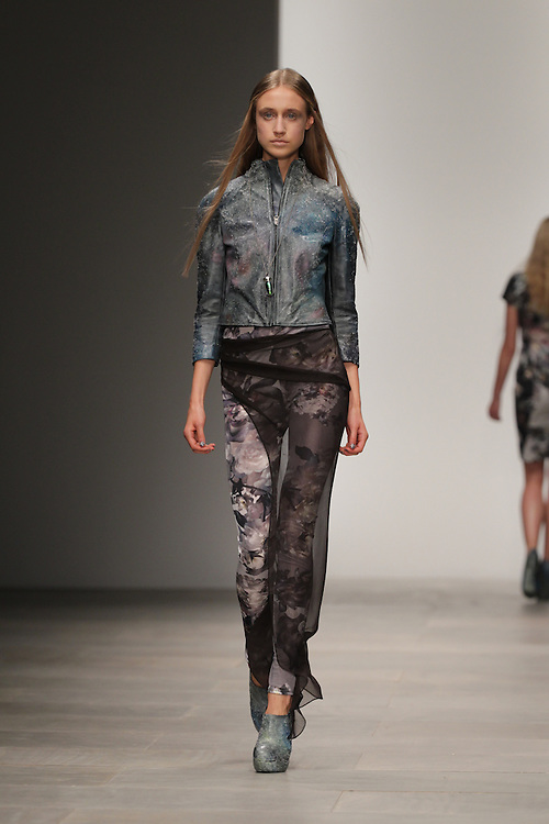 Models walk the runway for the Aminaka Wilmont Spring 2012 London Fashion Week show.