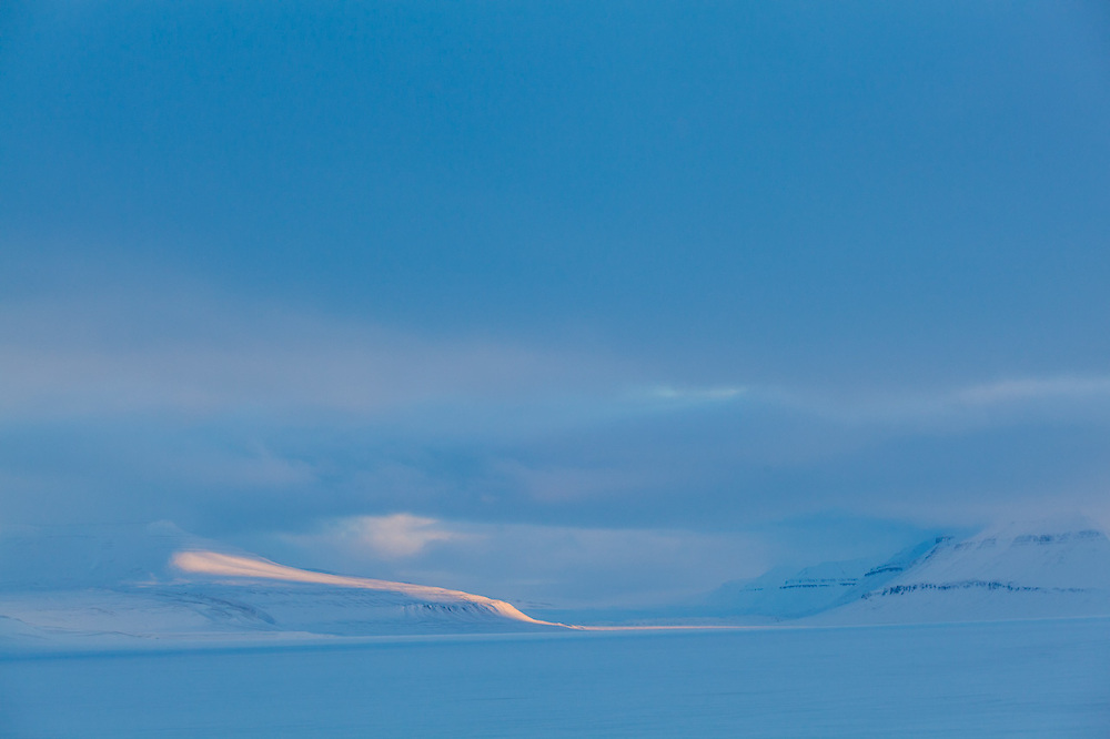 Sunrise shaft of light in Sassendalen, Svalbard.