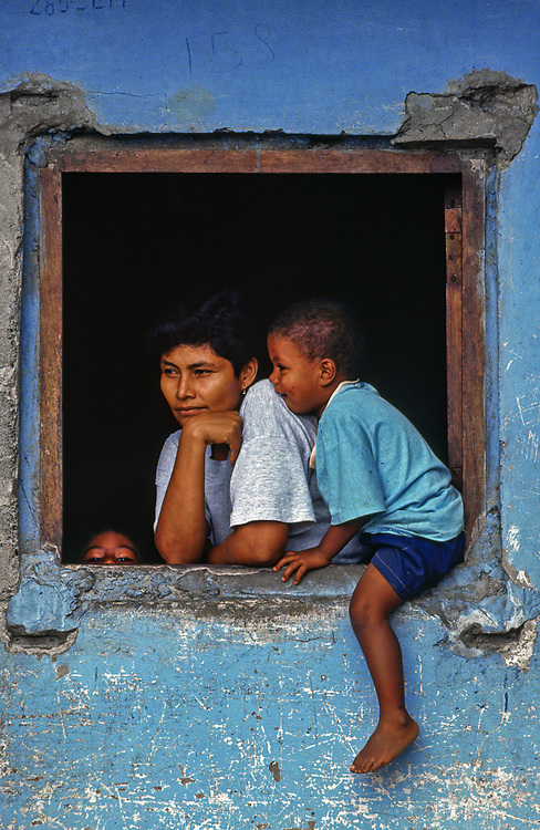 A mother and child sit at a window, Bahia Solano, Choco, Colombia. | Location: Bahila Solano, Choco, Colombia.ca. 1980-1995,