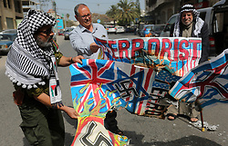 April 29, 2019 - Gaza City, Gaza Strip, Palestinian Territory - Palestinians burn an Israeli, British and U.S. flags during a protest to show solidarity with Palestinian prisoners held in Israeli jails, in front of Red Cross office in Gaza city.  (Credit Image: © Ashraf Amra/APA Images via ZUMA Wire)