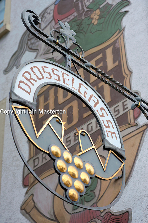 Sign on famous tourist Drosselgasse Street in popular town of Rudesheim on River Rhine in Germany