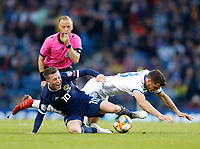 Football - 2018 / 2019 UEFA European Championship Qualifier - Group I: Scotland vs. Cyprus<br /> <br /> Callum McGregor of Scotland vies with Ioannis Kousoulos of Cyprus during the European Championship Qualifying match between Scotland and Cyprus, at Hampden Park, Glasgow.<br /> <br /> COLORSPORT/BRUCE WHITE