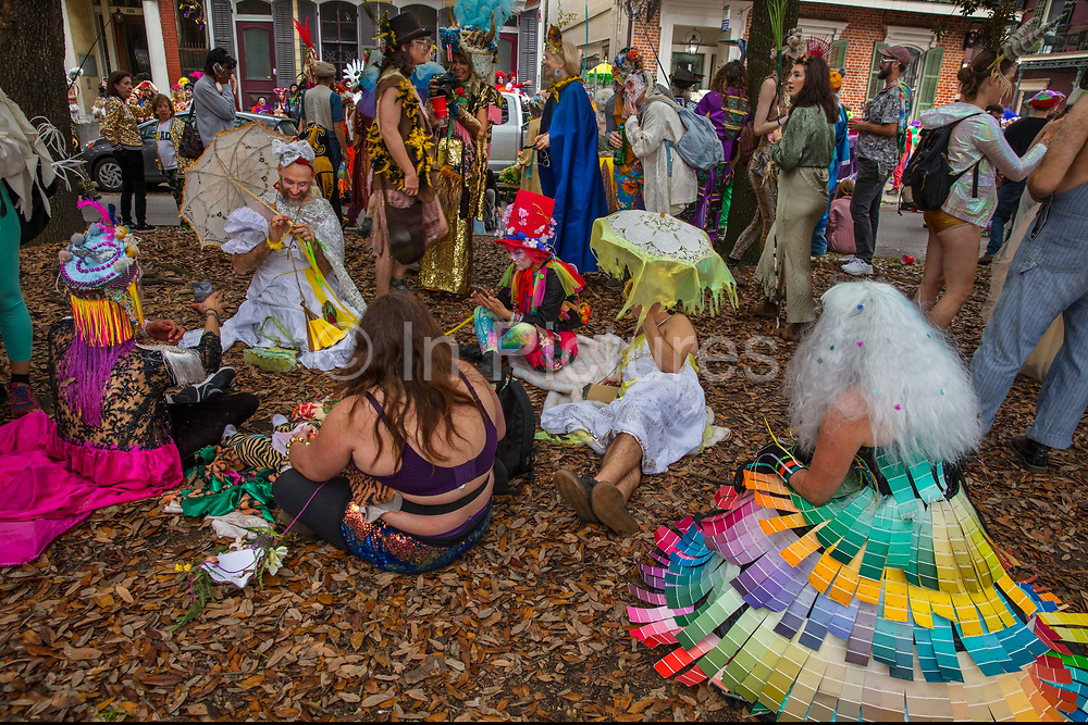 A picnic break for the Society of Saint Anne parade during Mardi Gras on 25th February 2020 in Bywater district of New Orleans, Louisiana, United States. Mardi Gras is the biggest celebration the city of New Orleans hosts every year. The magnificent, costumed, beaded and feathered party is laced with tradition and  having a good time. Celebrations are concentrated for about two weeks before and culminate on Fat Tuesday the day before Ash Wednesday and Lent.