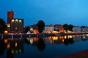 The black basalt lava stone cathedral. L'Herault river. Agde town. Languedoc. France. Europe. St Etienne cathedral from the 12 century.
