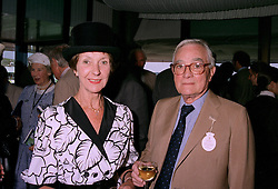 MR & MRS WALTER HAYES he is life president of Aston Martin Lagonda Ltd., at a race meeting in Sussex on 29th July 1997.MAS 28