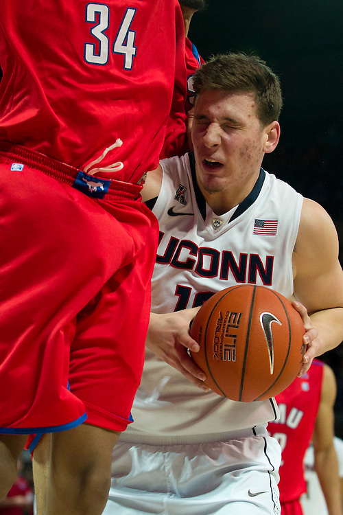 DALLAS, TX - JANUARY 4: Tyler Olander #10 of the Connecticut Huskies drives to the basket against the SMU Mustangs on January 4, 2014 at Moody Coliseum in Dallas, Texas.  (Photo by Cooper Neill) *** Local Caption *** Tyler Olander