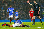 Alfredo Morelos ends up on the ground again, this time winning a free kick during the William Hill Scottish Cup quarter final replay match between Rangers and Aberdeen at Ibrox, Glasgow, Scotland on 12 March 2019.