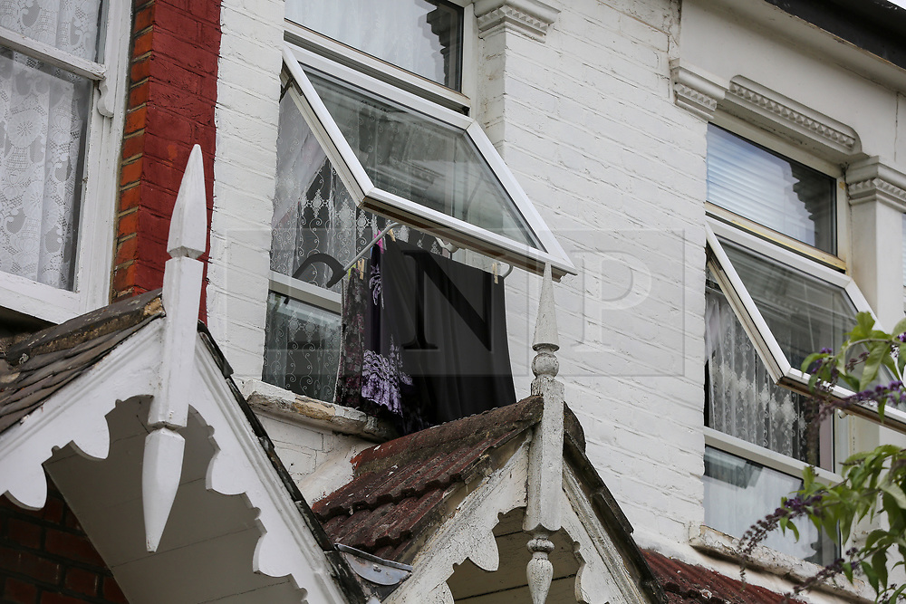 © Licensed to London News Pictures. 14/06/2020. London, UK. Open windows at a residential property on Waldegrave Road in Haringey, north London as police launch a murder investigation following fatal stabbing. Police were called at 23.58hrs on Saturday, 13 June to Waldegrave Road, following reports of a 48-year-old man with stab injuries. Officers and London Ambulance Service attended and the man was taken to hospital. He died just before 01.00hrs on Sunday, 14 June. A 42-year-old man has been arrested on suspicion of murder. He is thought to be known to the victim. Photo credit: Dinendra Haria/LNP