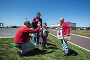 A woman and her two children stopped to thank striking Verizon workers and gave them refreshments from a nearby restaurant. The mother thanked them for standing up to corporate greed and her son high-fived splicing tech Pete Sanders, who has worked for the phone company for more than 28 years.