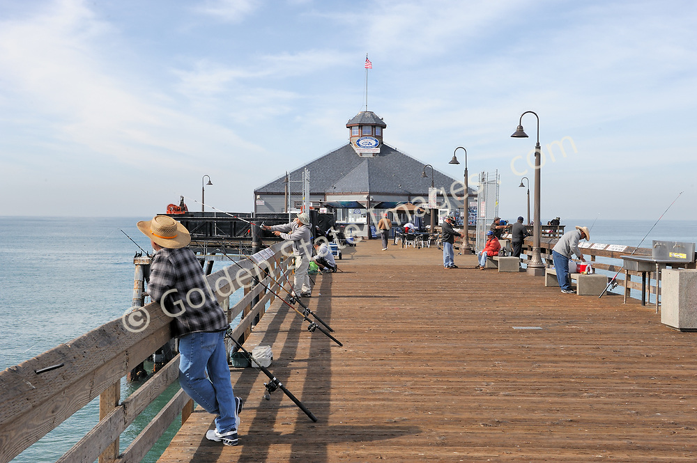 The pier is very popular for fishing. Tin Fish Cafe in background.