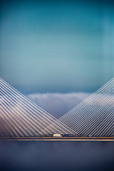 The Queensferry Bridge, The Forth Road Bridge and The Forth Bridge rise in this evenings haar, the coastal fog which typically forms in Spring and Summer over eastern Scotland. The Queensferry Bridge appears through the evening haar, on 27/6/2018. The haar is a coastal fog which typically forms in Spring and Summer over eastern Scotland.
