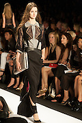 A black dress with gray and beige lace accents and suspenders at the BCBGMAXAZRIA show at the Spring 2013 Mercedes Benz Fashion Week show in New York.