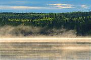 Fog rising above the Suwannee River at dawn<br />near Leaf Rapids<br />Manitoba<br />Canada