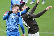 Fussball: 2. Bundesliga, FC St. Pauli - Holstein Kiel, Hamburg, 09.01.2021<br /> Jannik Dehn (Kiel, l.) - Igor Matanovic (Pauli)<br /> © Torsten Helmke