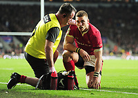 Rugby Union - 2020 Guinness Six Nations Championship - England vs. Wales<br /> <br /> George North of Wales receives attention from the trainer, after Manu Tuilagi's challenge which he was  sent off for at Twickenham.<br /> <br /> COLORSPORT/ANDREW COWIE