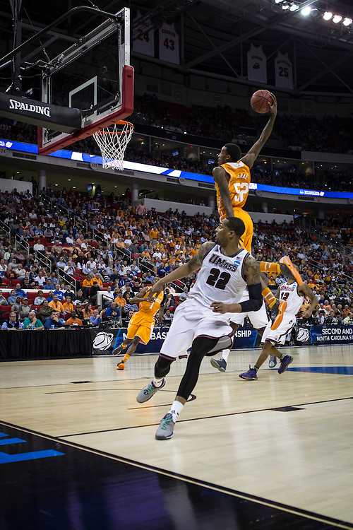 Tennessee Volunteer's guard Jordan McRae (52) readies to slam dunk the ball into the basket against UMASS at PNC Arena on March 21 during the NCAA Men's Division I Round of 64 games. Tennessee went on to win 86-67 to advance to the Round of 32 against Mercer.