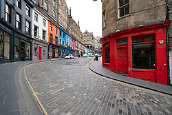 Edinburgh, Scotland, UK. 24 March, 2020.  Deserted streets in the heart of the Old Town tourist district in Edinburgh. All shops and restaurants are closed with very few people venturing outside following the Government imposed lockdown today. Pictured; View along empty Victoria Street and West Bow. Iain Masterton/Alamy Live News