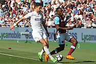 Michail Antonio of West Ham United (R) is tackled by Federico Fernandez of Swansea City (L) and then pulls up with a hamstring injury. Premier league match, West Ham Utd v Swansea city at the London Stadium, Queen Elizabeth Olympic Park in London on Saturday 8th April 2017.<br /> pic by Steffan Bowen, Andrew Orchard sports photography.