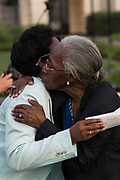 Relatives of the Emanuel 9, killed in a mass shooting at the historic Mother Emanuel African Methodist Episcopal Church, embrace following a remembrance ceremony marking the 4th anniversary of the mass shooting June 19, 2019 in Charleston, South Carolina. Nine members of the historically black congregation were gunned down during bible study by a white supremacist on June 17, 2015.