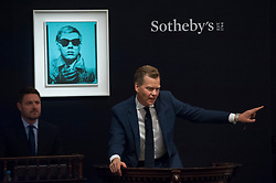 "© Licensed to London News Pictures. 28/06/2017. London, UK. ""Self-Portrait"", 1963-64, by Andy Warhol sold for a hammer price of GBP5.2m (estimate GBP5-7m) at Sotheby's Contemporary Art evening sale in New Bond Street, which featured pioneering works from the Pop Art genre. Photo credit : Stephen Chung/LNP"