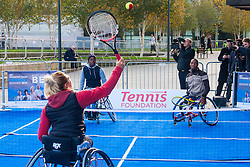 City Hall, London, November 24th 2014. Mayor Boris Johnsonwelcomes the world's best wheelchair tennis players with a game of mini tennis outside City Hall. The players are in London to compete in the NEC Wheelchair Tennis Masters 2014, being held at the Lee Valley Hockey and Tennis Centre, being held from 26 - 30 November. PICTURED: Wheelchair Tennis players Jordanne Whiley, back to camera, Kgothatso Montjane, far left and Lucas Sithole knock about outside City Hall.