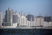 Construction sites line the banks of the Dandong side of the Yalu River on the border of North Korea October 11, 2006.  DPRK, north korea, china, dandong, border, liaoning, democratic, people's, rebiblic, of, korea, nuclear, test, rice, japan, arms, race, weapons, stalinist, communist, kin jong il